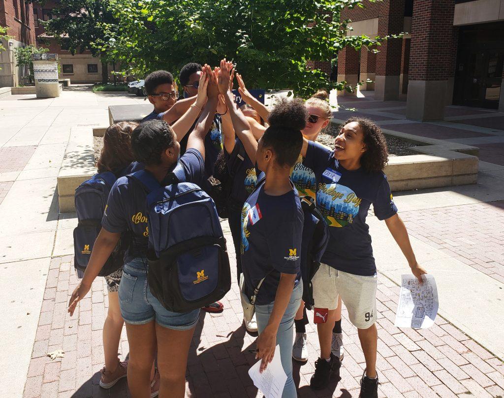 High school students high five