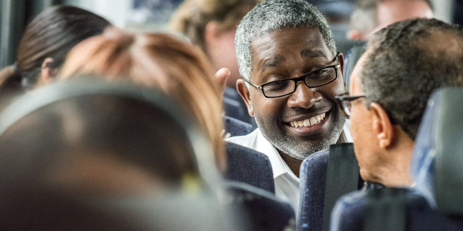 Man smiling on a bus