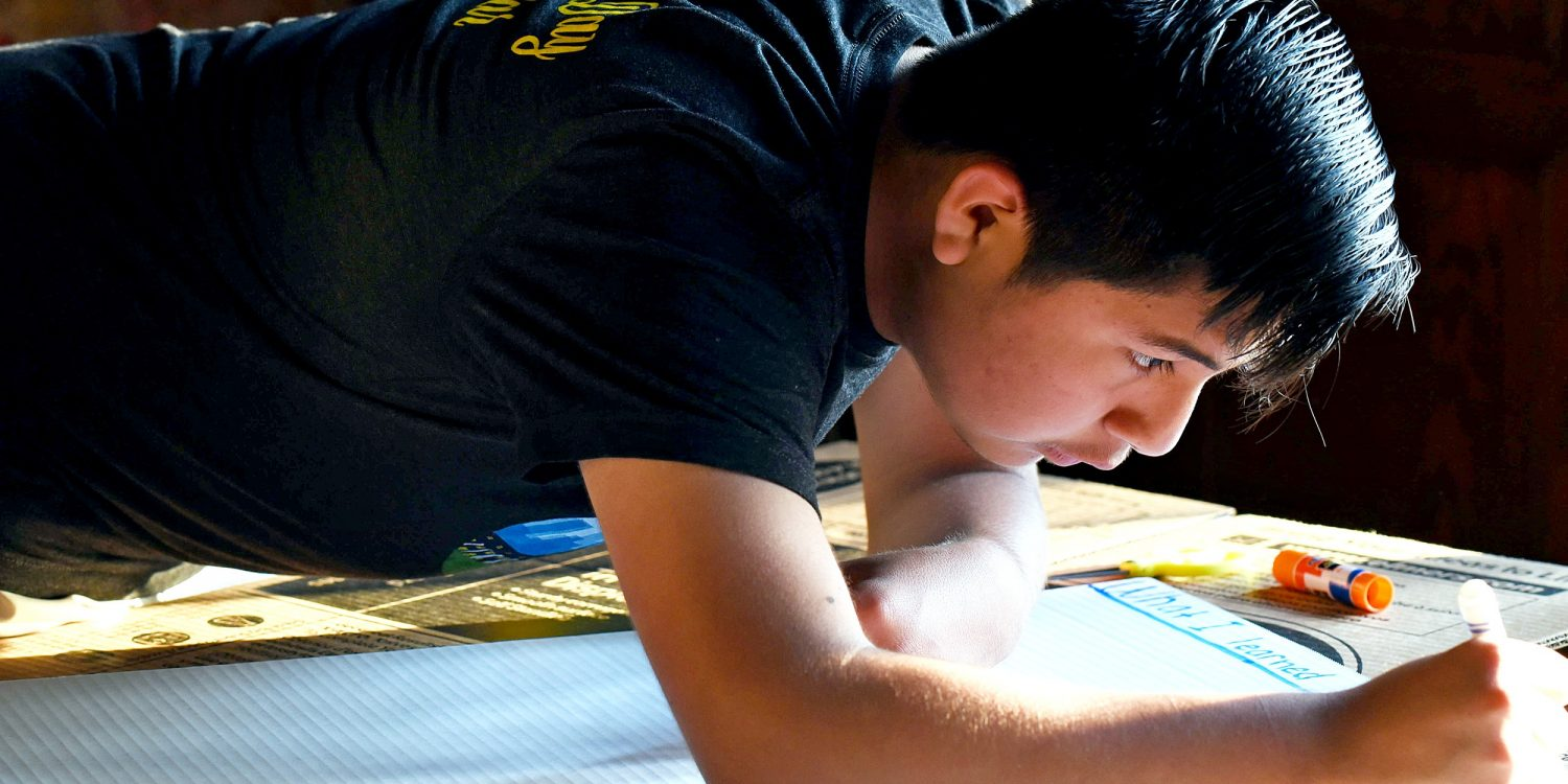 Close-up on a student making a poster