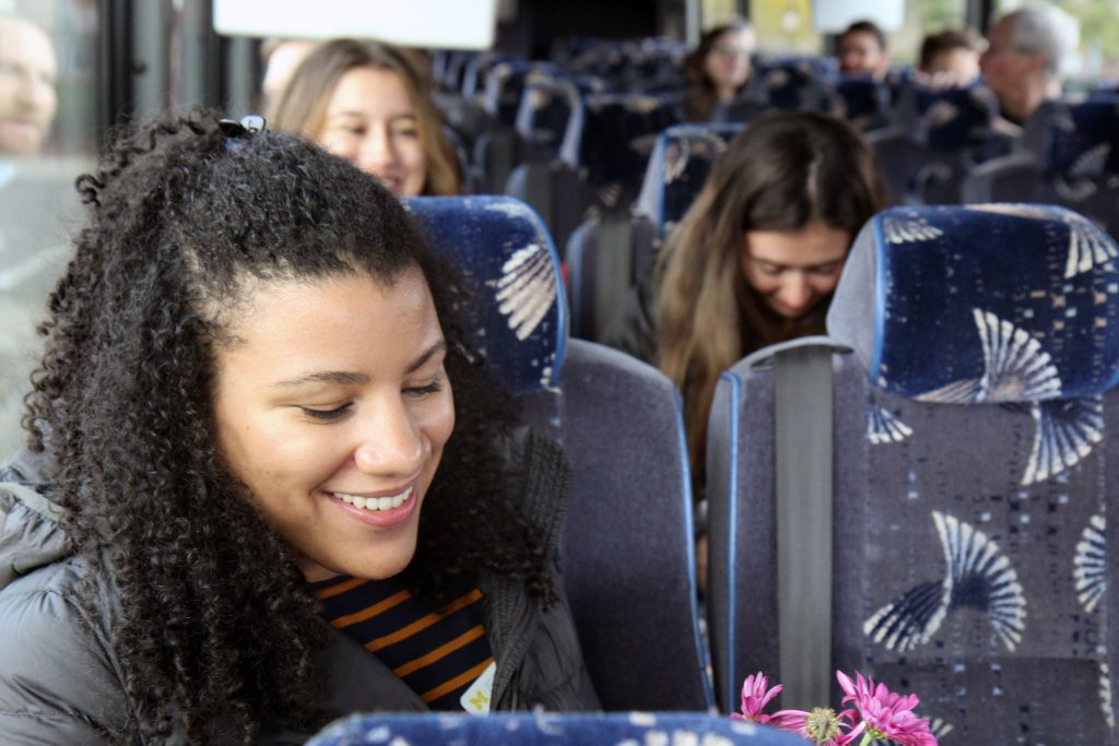 Woman smiling on a bus